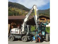 Bagger Terex mit Prozessorkopf und Traktor Fendt Xylon mit Penz-Kran
