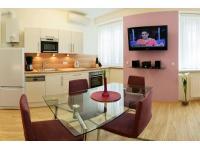 Wohnzimmer mit integrierter Küche 2. Ansicht : Studioapartment 38m2 mit WIFI und Klimaanlage