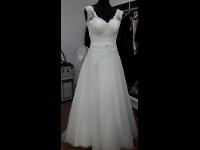 wir passen ihr Brautkleid an