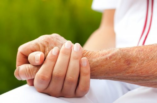 Doctor holding hand of an elderly woman