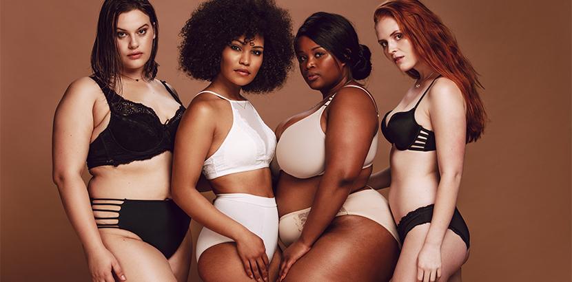 Dessous Wien: vier diverse Frauen mit verschiedenen Größen in Unterwäsche
