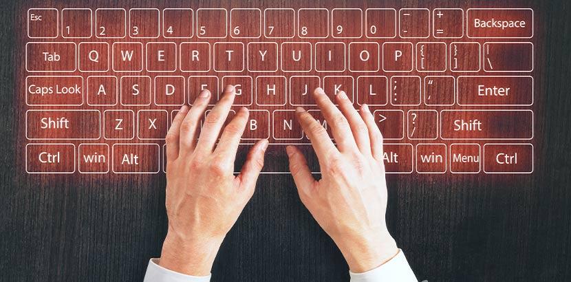 Männerhände, die auf einer Laser Tastatur schreiben. Geschenke für Männer.