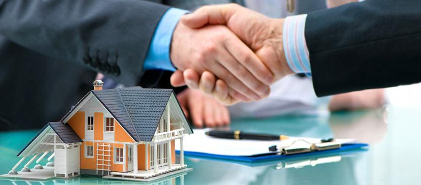 Grunderwerbsteuer: Handschlag nach Immobilienverkauf