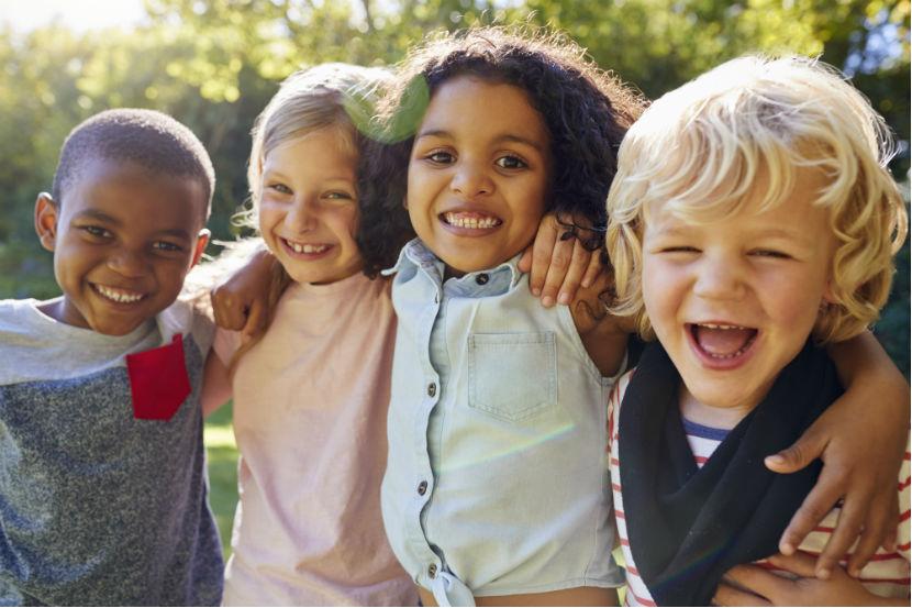 Kindergarten Wien: Vier spielende Kinder.