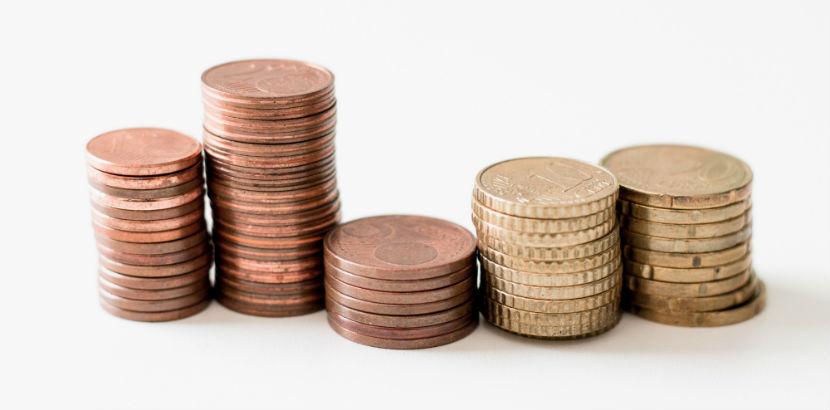 Steuberater Graz: Cent Münzen getürmt.