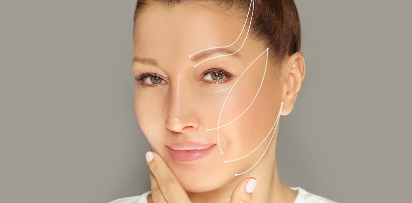 Auf dem Gesicht einer Frau ist der Verlauf der Fäden nachgezeichnet.